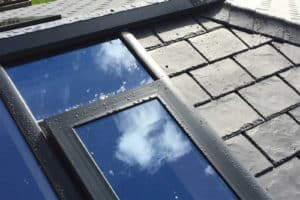 Tiled roof with glass panels
